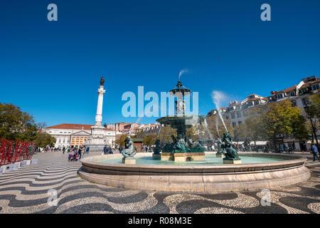 Fountain, bronze fountain with monument Dom Pedro IV, National Theatre at Rossio Square, Praça Rossio, Lisbon, Portugal - Stock Photo