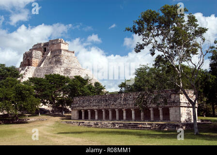 The Pyramid of the Magician (Piramide del Adivino) and a small, courtyard building in the Mayan city of Uxmal, Mexico. - Stock Photo