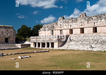 Mayan buildings with elaborately carved facades comprise the Nunnery Quadrangle at Uxmal, Mexico. - Stock Photo