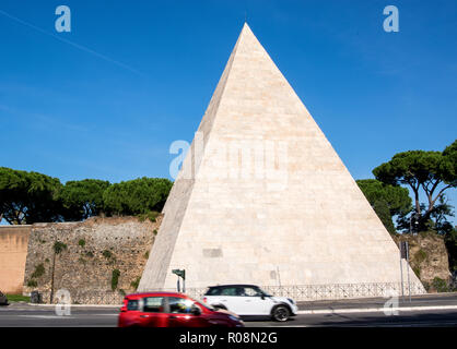 The Pyramid of Cestius is an ancient (18–12 BC) pyramid in Rome, Italy, near the Porta San Paolo and the Protestant Cemetery. - Stock Photo