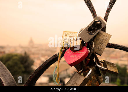 Rome, Italy - October  12, 2018: Lovers padlocks on a bridge. View from the Pincian hill in Rome, Italy - Stock Photo