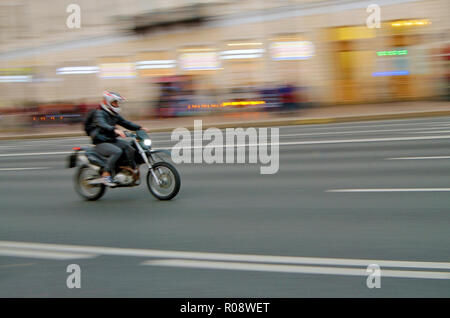 Motorcyclist rides fast on the road.Have transport much the speed. - Stock Photo