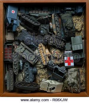 Auction haul - box full of Corgi toys - military - Stock Photo