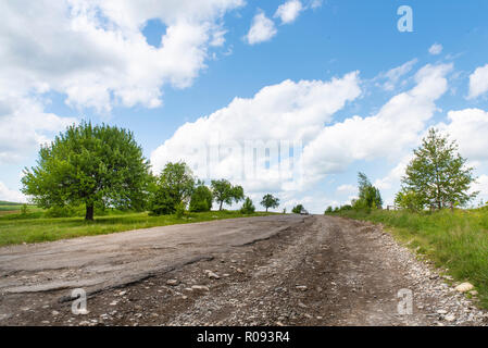 Completely destroyed road, difficult traffic area, threat of damage to vehicle. Countryside - Stock Photo