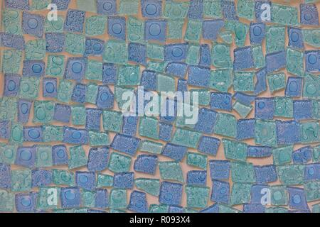 A mosaic pattern of uneven tiles with two-tone blues and a glossy finish. - Stock Photo