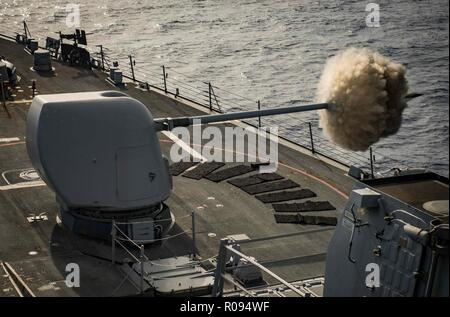 181101-N-UY653-106  MEDITERRANEAN SEA (Nov. 1, 2018) The Arleigh Burke-class guided-missile destroyer USS Carney (DDG 64) fires its 5-inch gun during a live-fire exercise Nov. 1, 2018. Carney, forward-deployed to Rota, Spain, is on its fifth patrol in the U.S. 6th Fleet area of operations in support of regional allies and partners as well as U.S. national security interests in Europe and Africa. (U.S. Navy photo by Mass Communication Specialist 1st Class Ryan U. Kledzik/Released) - Stock Photo