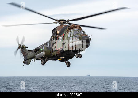 NORWAY, Oct. 31 2018. GEN. SNMG2 VESSELS ESCORT AMPHIBIOUS TASK GROUP. HNLMS JOHAN DE WITT COUGAR HELICOPTER CROSSDECK.   Trident Juncture 18 is designed to ensure that NATO forces are trained, able to operate together and ready to respond to any threat from any direction. Trident Juncture 18 takes place in Norway and the surrounding areas of the North Atlantic and the Baltic Sea, including Iceland and the airspace of Finland and Sweden.   With around 50,000 participants from 31 nations Trident Juncture 2018 is one of NATO's largest exercises in recent years. More than 250 aircraft, 65 ships a - Stock Photo