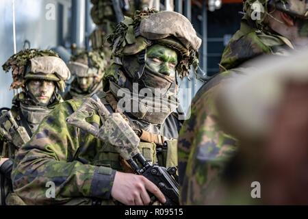 NORWAY, Oct. 30. 2018. Finnish troops from the Nyland Brigade , Vasa Coastal Jaeger Battalion based in Raasepuri, embark aboard HNLMS Johan de Witt Landing Craft for Vehicle and Personnel (LCVP) involved in the Amphibious Assault, part of Trident Juncture DV Day.    Trident Juncture 18 is designed to ensure that NATO forces are trained, able to operate together and ready to respond to any threat from any direction. Trident Juncture 18 takes place in Norway and the surrounding areas of the North Atlantic and the Baltic Sea, including Iceland and the airspace of Finland and Sweden.   With around - Stock Photo