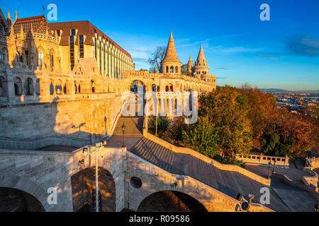 Budapest, Hungary - Golden sunrise at the Fisherman's Bastion with Matthias Church and clear blue sky at autumn - Stock Photo