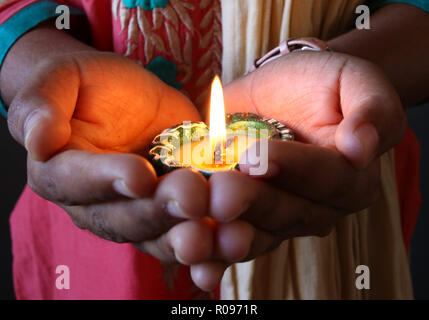 A close-up view of lit diya - Stock Photo
