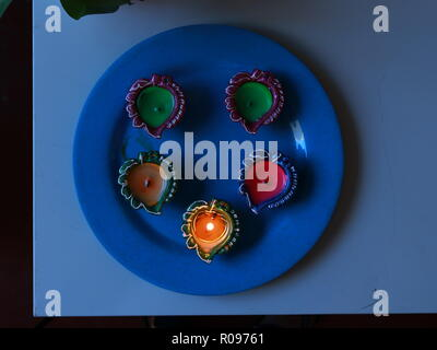 5 Diyas arranged on a table for the celebration of diwali and dhanteras - Stock Photo