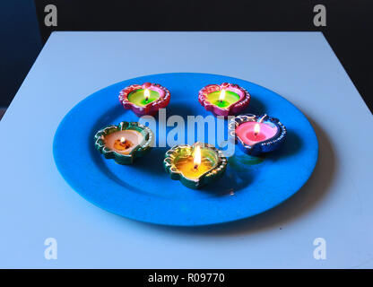 5 Diyas arranged in a plate,placed on table for the celebration of diwali and dhanteras - Stock Photo