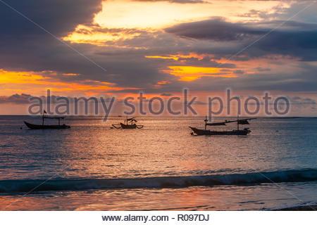 Bali, Indonesia. Fishing boats at sunset. Travel landscape. - Stock Photo