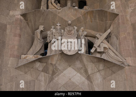 A sculpture of Jesus carrying a cross on the exterior wall of the Sagrada Familia, Barcelona, Spain - Stock Photo