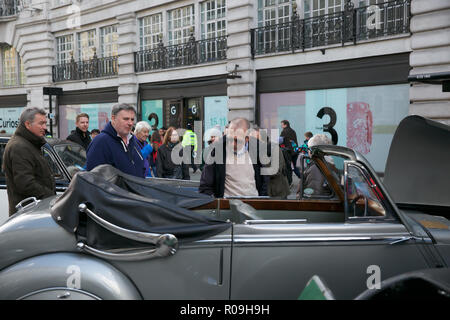London, UK. 3rd Nov, 2018. Large crowds attend The annual Regent Street Motor Show which takes place in London. London to Brighton Veteran Cars were on display, ahead of their run to brighton tomorrow, along with Jaguars, Volkswagen Beetles and many other Models. Credit: Keith Larby/Alamy Live News - Stock Photo