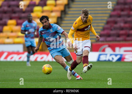 Fir Park, Motherwell, UK. 3rd Nov, 2018. Ladbrokes Premiership football, Motherwell versus Dundee; Chris Cadden of Motherwell and Sofien Moussa of Dundee Credit: Action Plus Sports/Alamy Live News - Stock Photo