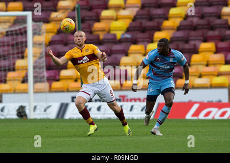 Fir Park, Motherwell, UK. 3rd Nov, 2018. Ladbrokes Premiership football, Motherwell versus Dundee; Curtis Main of Motherwell and Genserix Kusunga of Dundee Credit: Action Plus Sports/Alamy Live News - Stock Photo