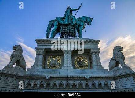 A bronze statue of Stephen I of Hungary mounted on a horse, erected in 1906, can be seen between the Bastion and the Matthias Church. - Stock Photo