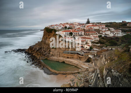 View of the Picturesque village Azenhas do Mar, on the edge of a cliff with a beach below. Landmark near Sintra, Lisbon, Portugal, Europe. landscape. - Stock Photo
