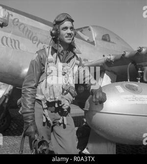 Tuskegee Airman Edward C. Gleed of Lawrence, Kansas, Class 42-K, Group Operations Officer, Three-quarter Length Portrait, Wearing Flight Gear, with Left Arm Resting on Airplane at Air Base, Ramitelli, Italy, Toni Frissell, March 1945