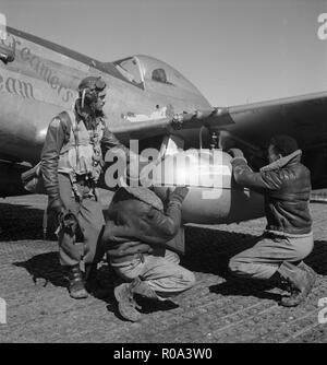 Tuskegee airman Edward C. Gleed, Lawrence, KS, Class 42-K, with two Unidentified Crewmen Adjusting  External Drop Tank on Wing of a P-5/D Airplane, Ramitelli, Italy, Toni Frissell, March 1945