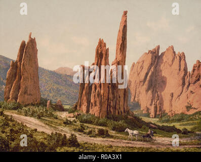Horse and Buggy Passing by Tall Rock Formations, Cathedral Spires, Garden of the Gods, Colorado Springs, Colorado, USA, William Henry Jackson for Detroit Publishing Company, 1905 - Stock Photo