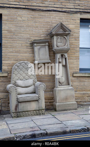 Grandad's Clock and Chair, a stone sculpture in the Little Germany area of Bradford in West  Yorkshire - Stock Photo