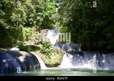 YS falls is a popular natural tourist attraction in Saint Elizabeth Parish, Jamaica. It is a seven tiered waterfall which cascade into natural pools. - Stock Photo