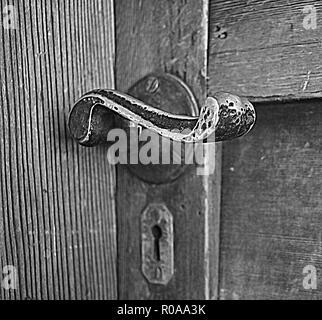 Old style lever door handle on western red cedar door - Stock Photo