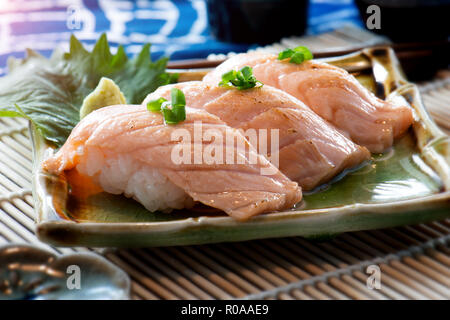 Japanese style salmon sushi serve in plate. - Stock Photo