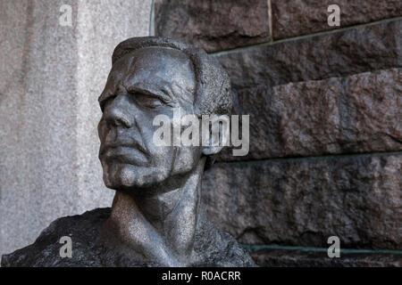Head sculpture of Gustav Sandberg, Swedish artist and sculptor, outside City Hall (Stadshuset), Stockholm, Sweden. - Stock Photo