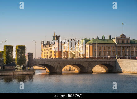 Stockholm, Sweden. Cityscape view of historic buildings on Stromgaten, with Norrbro arched bridge in the centre of Stockholm on a sunny autumn day. - Stock Photo