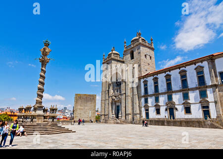 LISBON, PORTUGAL - JUNE 19, 2013: Facade view of Porto Cathedral (Portuguese: Se do Porto) in historic center of Porto city, Portugal. Built in 12th c - Stock Photo