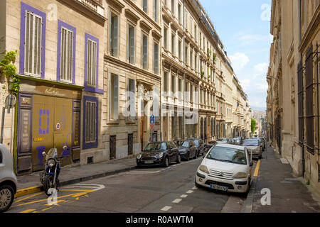 The view down the long avenue of Rue Sylvabelle, Marseille, France. - Stock Photo
