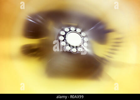 1998 HISTORICAL OLD FASHIONED TELEPHONE ON YELLOW BACKGROUND - Stock Photo
