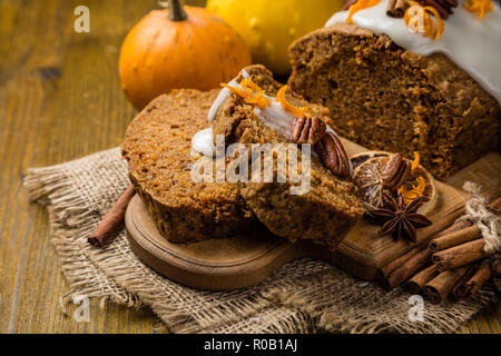 Carrot cake with autumn decorations, rustic wood background - Stock Photo