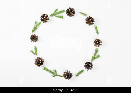 Christmas composition. Round frame of fir branches, pine cones on white background. Flat lay, top view, copy space, - Stock Photo
