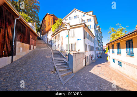 Old cobbled street scene of Zurich, largest city in Switzerland - Stock Photo