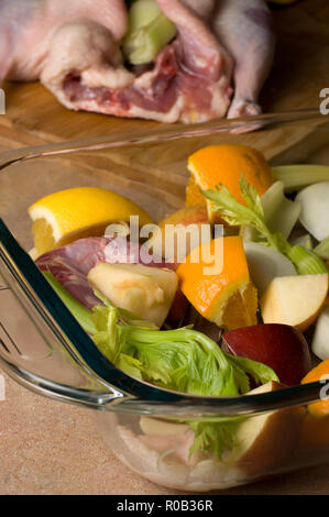 Fresh Uncooked Duck with Vegetables on Wood Counter - Stock Photo