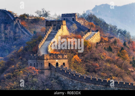 The Great Wall of China in a distant view with compressed towers and wall segments during autumn season in mountains near Beijing as ancient fortifica - Stock Photo