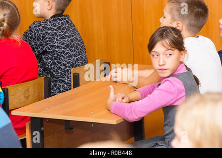 Schoolgirl in class at the Desk - Stock Photo