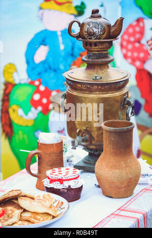 Rustic old cookware with a copper samovar vintage style - Stock Photo