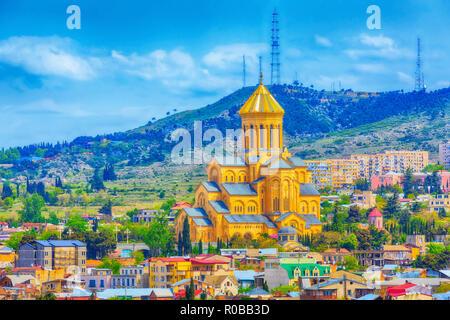 Tbilisi, Georgia aerial skyline with old traditional houses and Holy Trinity church or Tsminda Sameba Cathedral - Stock Photo