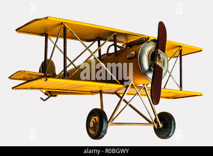 Yellow toy plane on an isolated background - Stock Photo