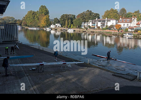 A rower prepares his rowing boat at the Marlow Rowing Club beside the river Thames at Marlow in Buckinghamshire, Britain - Stock Photo