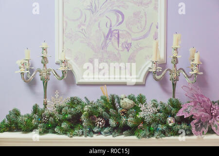 Design elements in the New Year and Christmas style in the form of candlesticks with candles and a branch with needles and decorations - Stock Photo