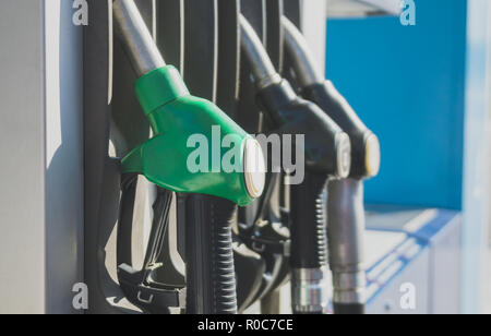 Three refueling nozzles on gas station. - Stock Photo