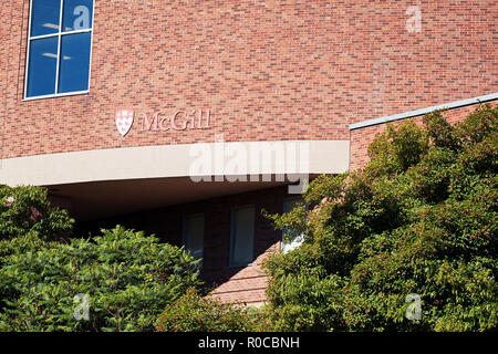 Exterior view of Mc Gill university brick building and the logo in Montreal, Quebec, Canada. - Stock Photo