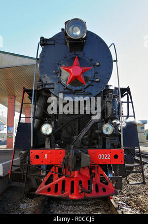 Russian retro steam locomotive series L with symbol of former state the USSR and red wheels. Part of a retro train - Stock Photo