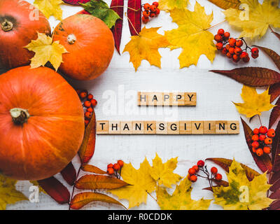 Bright Thanksgiving greeting card with ripe pumpkins, autumn leaves and and inscription. Preparing for the holidays. Congratulations for loved ones, r - Stock Photo